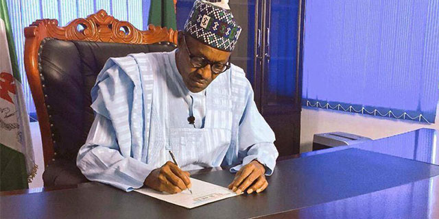 finally,buhari signs 2016 budget