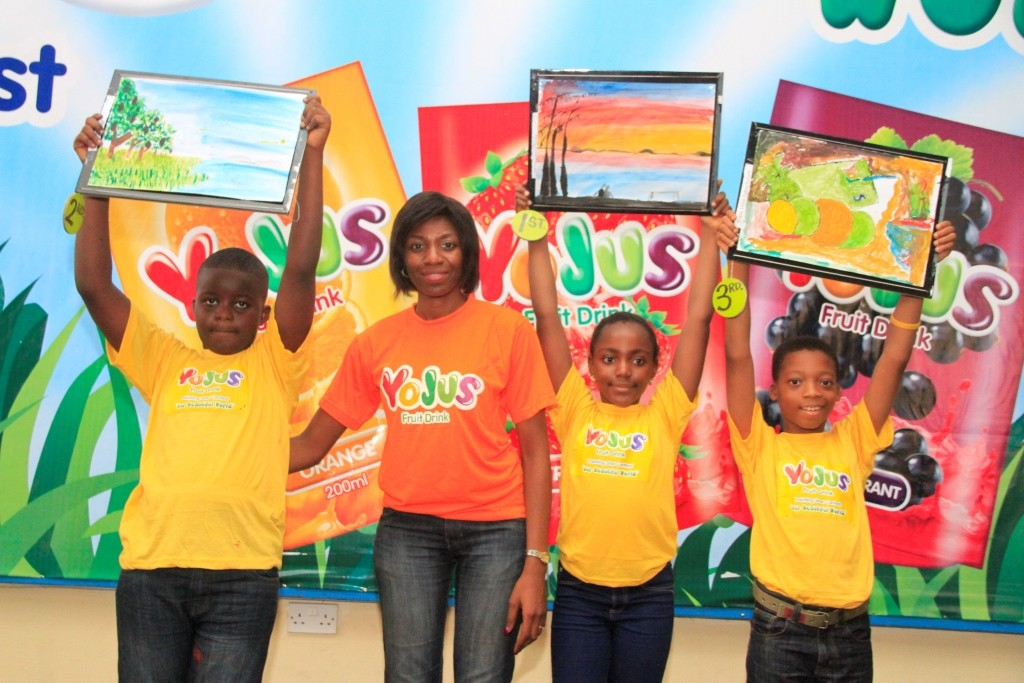 Brand Manager, Yojus Fruit Drink, Foluke Makinde (middle) flanked by winners in the Yojus Painting contest; Iyoha Peculiar (left); Chiziteram Onyia (3rd left) and Franc Uche Egbuchelam (right) at the 'Yojus Painting Star Contest', organized by Ranona, on Saturday, October 24, 2015, at the NAN Media Centre,  National Theatre Complex,  Iganmu, Lagos