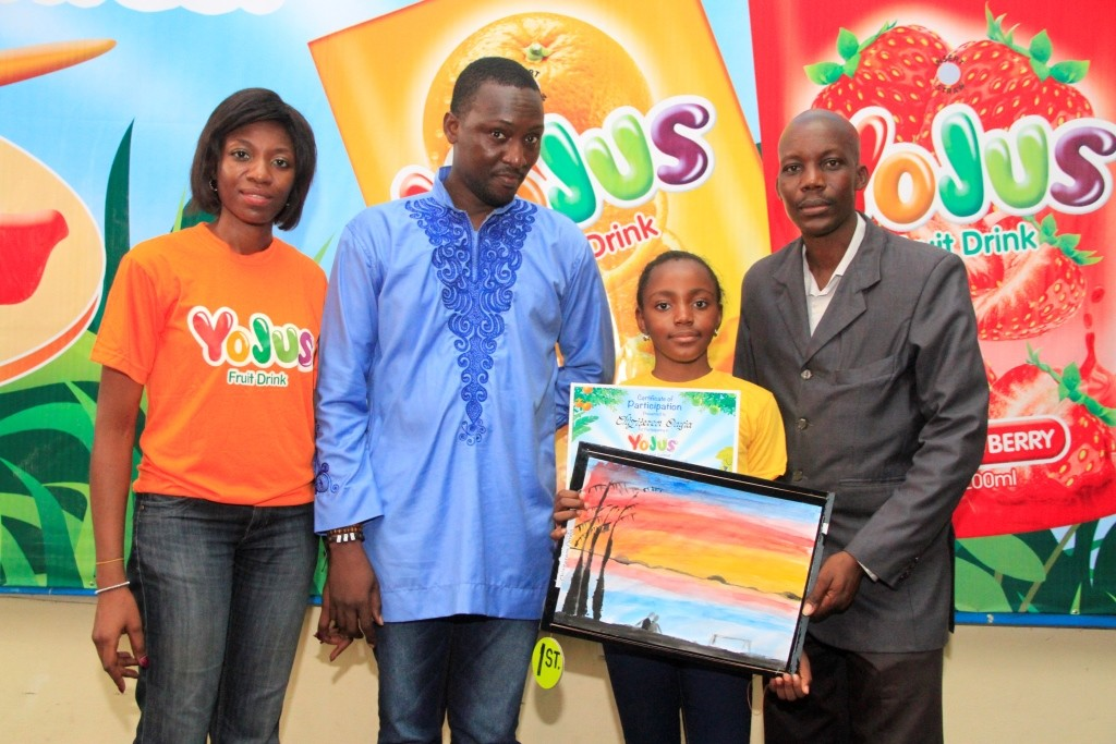 L-R: Brand Manager, Yojus Fruit Drink, Foluke Makinde; Art Educator, Ibrahim Ganiyu, Artist, Ayo Adenipekun with Winner, Yojus Painting Contest, Chiziteram Onyia  at the 'Yojus Painting Star Contest', organized by Ranona, on Saturday, October 24, 2015, at the NAN Media Centre,  National Theatre Complex,  Iganmu, Lagos