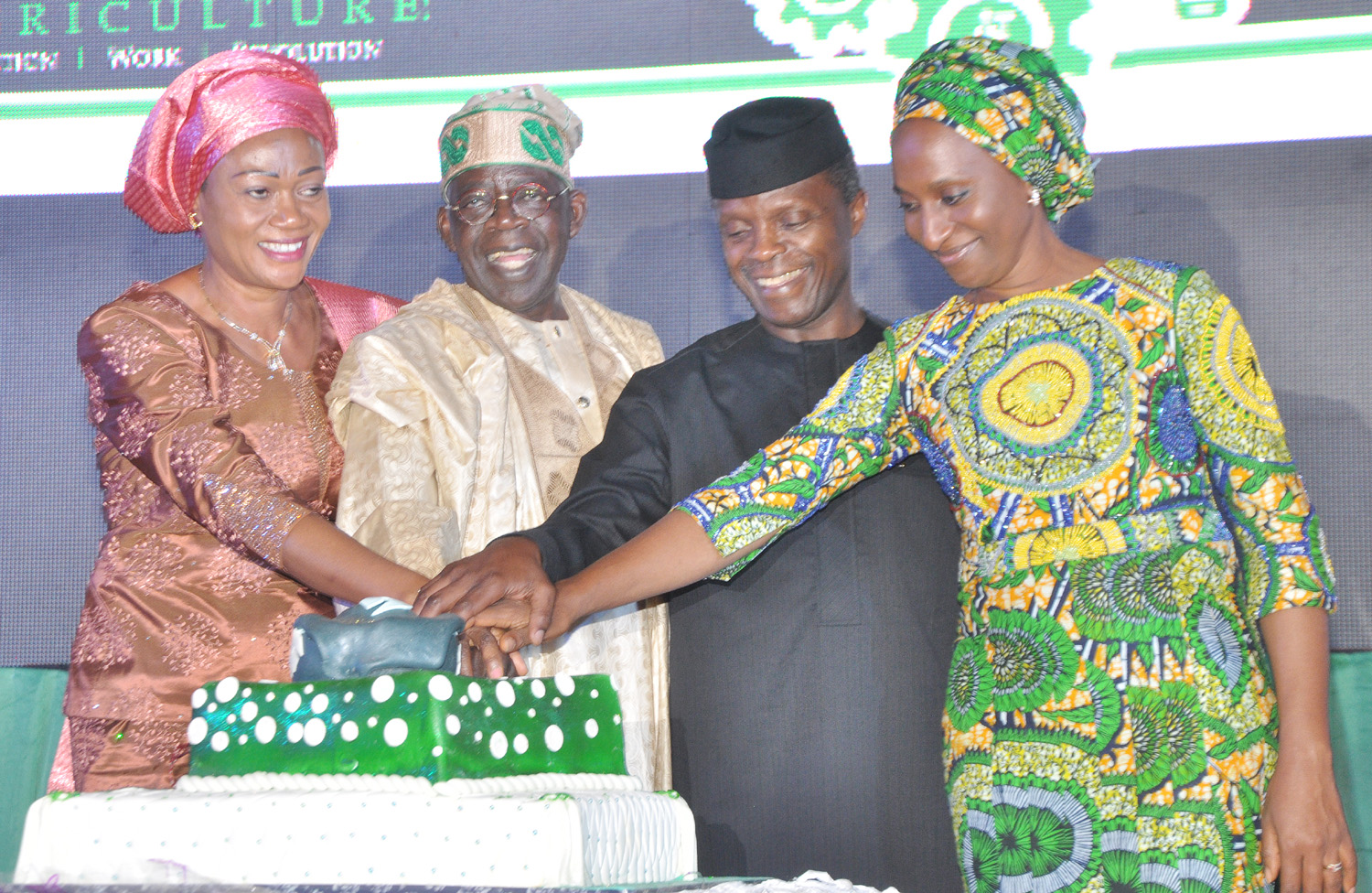 L-R, Sanator Remi Tinubu, Asiwaju Bola Ahmed Tinubu, Vice President Yemi Osinbanjo and wife of the vice president Mrs. Dolapo Osinbanjo cutting the cake to mark the 8th Bola Tinubu Colloquium to mark the 64th birthday of Asiwaju Bola Ahmed Tinubu