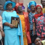 One of the Awardees .Mrs Olufunke familoni(m) with her Supporters after the Church service