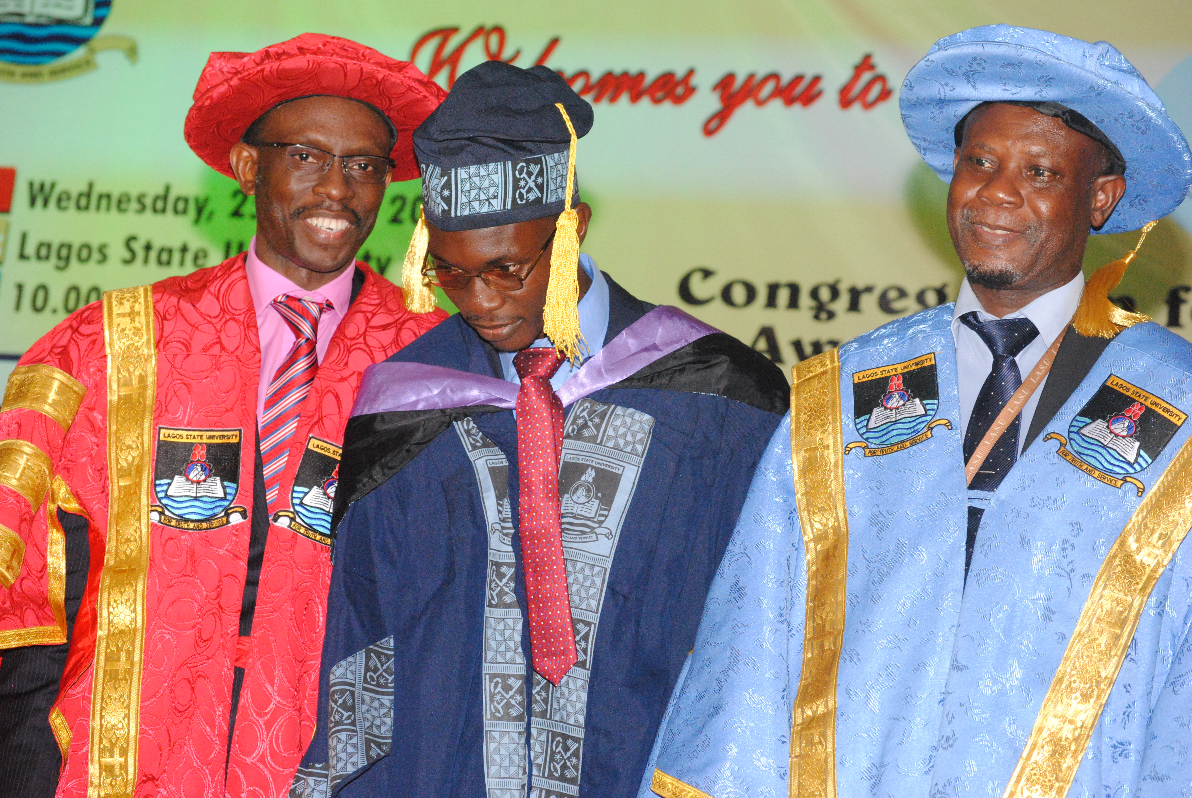 From left: Vice Chancellor, Lagos State University, Prof. Olanrewa Fagbohun, Overall Best Graduating Student of the Institution, Michael Arowosetgbe and the Bursar, Mr. Adetayo Hassan, during Lagos State University 20th Convocation Ceremony, held at the institution's premises, Ojo in Lagos. 25/05/2016. Photo
